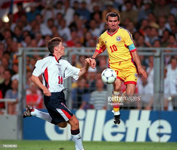 World Cup Finals Toulouse France 22nd June England 1 v Romania 2 Romania's Gheorghe Hagi in mid air to beat England's Darren Anderton