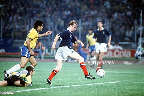 World Cup Finals Turin Italy 20th June Brazil 1 v Scotland 0 Scotland's Alex McLeish clears the ball from danger watched by Brazilian attacker Careca