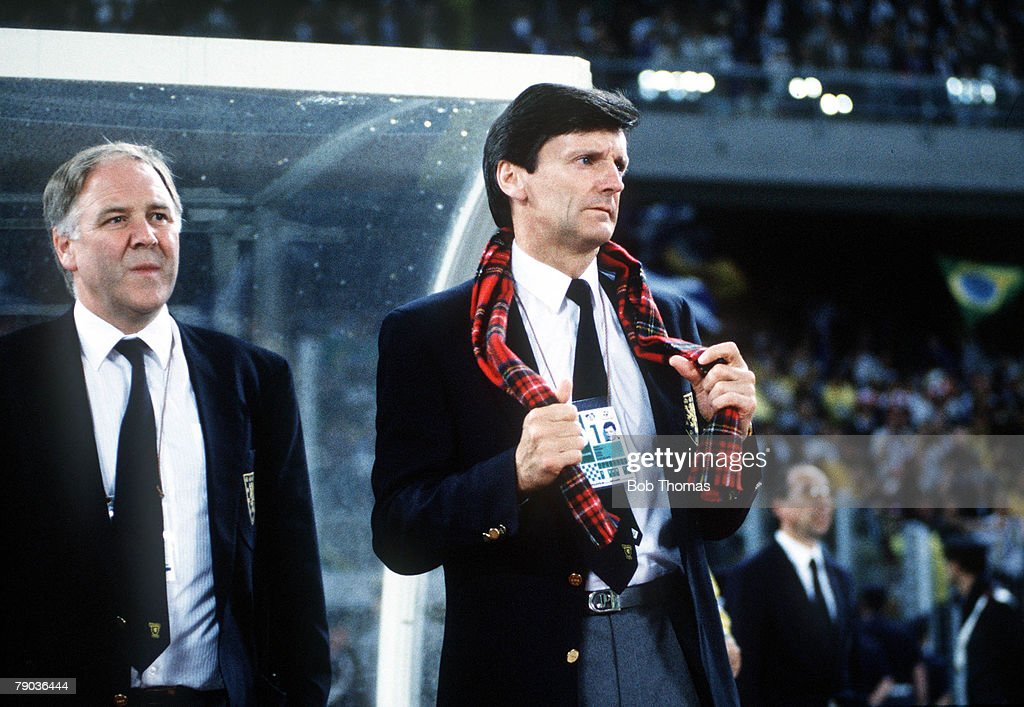 1990 World Cup Finals. Turin, Italy. 20th June, 1990. Brazil 1 v Scotland 0. Scotland's manager Andy Roxborough, waering a tartan scarf, watches the game with assistant Craig Brown. : News Photo