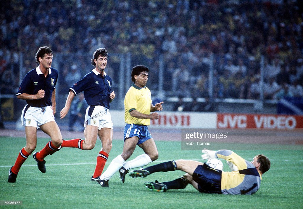 1990 World Cup Finals. Turin, Italy. 20th June, 1990. Brazil 1 v Scotland 0. Scottish goalkeeper makes a save from Brazil's Romario. : News Photo