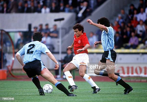 World Cup Finals Udine Italy 13th June Spain 0 v Uruguay 0 Spain's Francisco Villaroya is challenged for the ball by two Uruguayan defenders