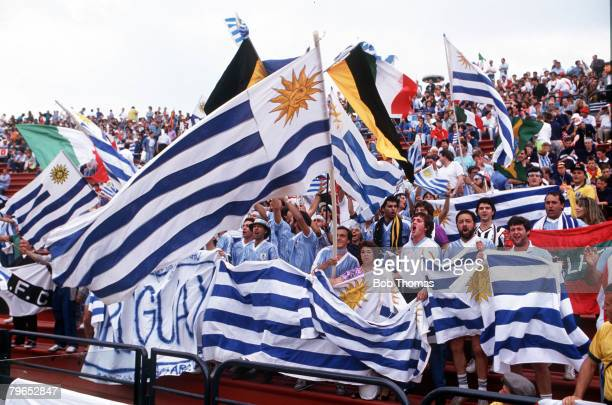 World Cup Finals Udine Italy 13th June Spain 0 v Uruguay 0 Uruguayan fans wave flags as they cheer on their team during the match