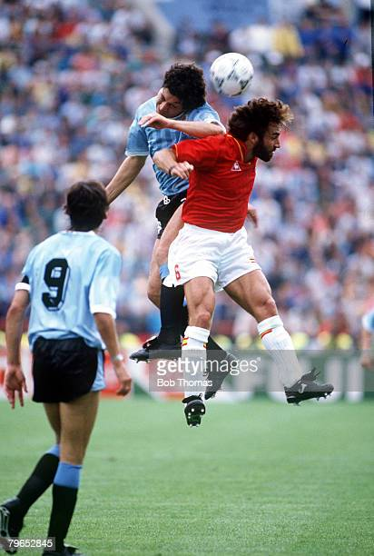 World Cup Finals Udine Italy 13th June Spain 0 v Uruguay 0 Uruguays's Jose Perdomo jumps up to beat Spain's Martin Vazquez to the ball in the air