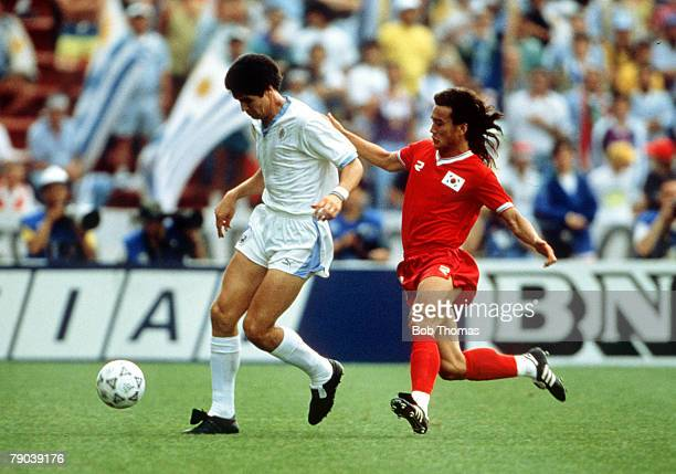 World Cup Finals Udine Italy 21st June Uruguay 1 v South Korea 0 Uruguay's Santiago Ostolaza is challenged for the ball by South Korea's Joo Sung Kim