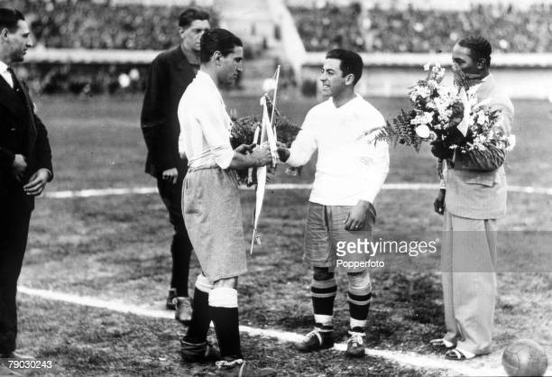 World Cup Finals Uruguay Argentina 3 v Chile 1 Argentine captain Manuel Ferreira exchanges pennants with Chilean captain Guillermo Subiabre before...