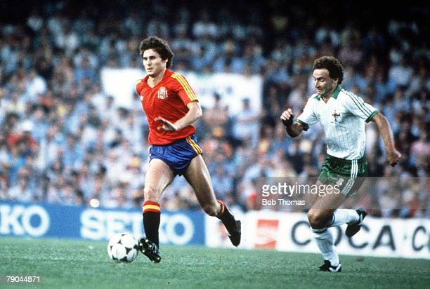 World Cup Finals Valencia Spain 25th June Spain 0 v Northern Ireland 1 Spain's Miguel Tendillo is chased by Northern Ireland's Martin O' Neill