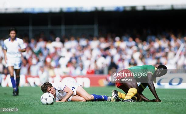 World Cup Finals Vigo Spain 23rd June 1982 Italy 1 v Cameroon 1 Italy's Marco Tardelli Cameroon's Emmanuel Kunde lie on the grass after colliding