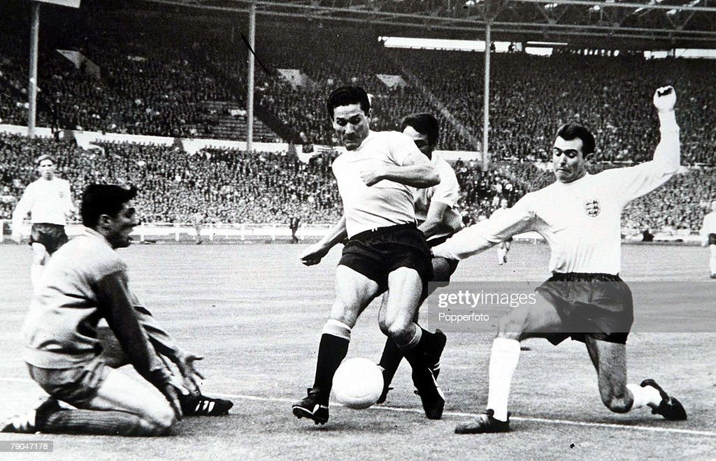 World Cup Finals, 1966. Wembley, England. 11th July, 1966 England 0 v Uruguay 0. England's John Connelly is stopped by the Uruguayan defence during the tournament's opening game. : News Photo