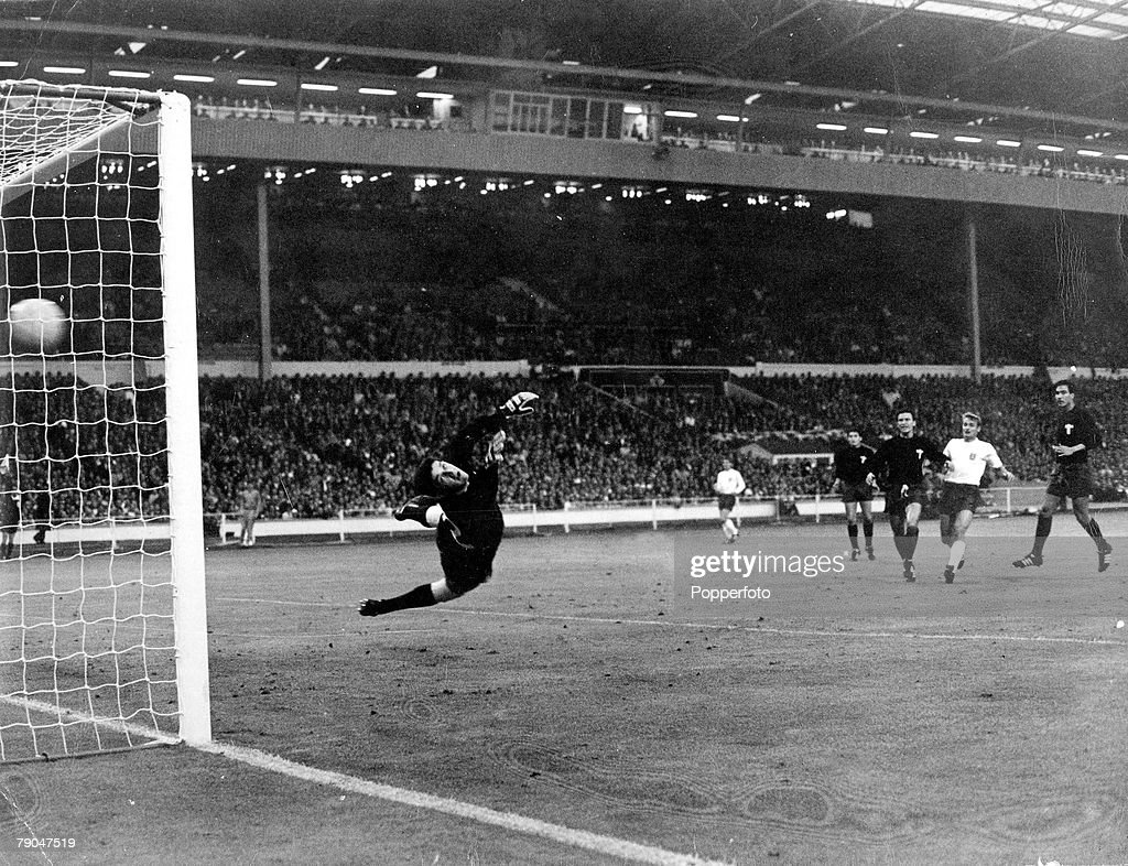 World Cup Finals, 1966, Wembley Stadium, England, 16th July, 1966, England 2 v Mexico 0, Mexico's goalkeeper Ignacio Calderon dives but cannot stop a shot from England's Bobby Charlton hitting the back of his net for the first goal during their Group One match.