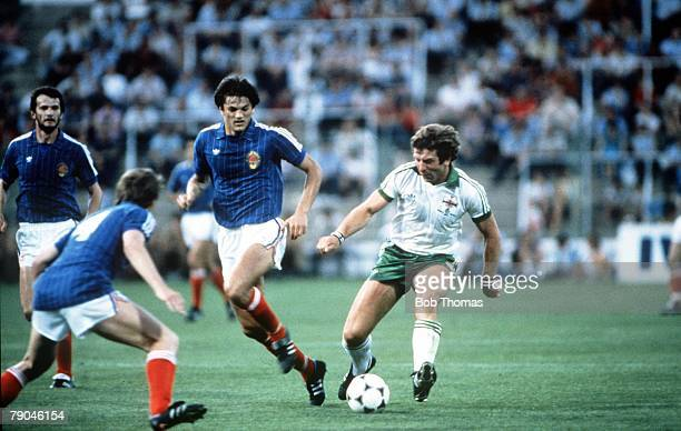 World Cup Finals Zaragoza Spain 17th June Yugoslavia 0 v NIreland 0 Northern Ireland's Gerry Armstrong is marked by Yugoslavia's Ivan Gudelj