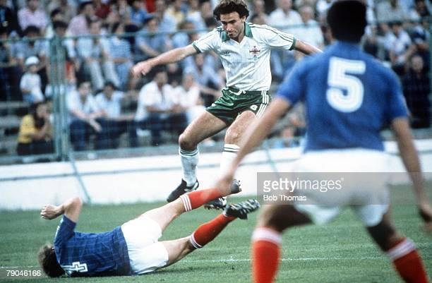 World Cup Finals Zaragoza Spain 17th June Yugoslavia 0 v NIreland 0 Northern Ireland's Martin O'Neill leaps over Yugoslavia's Velimir Zajec as Nenad...
