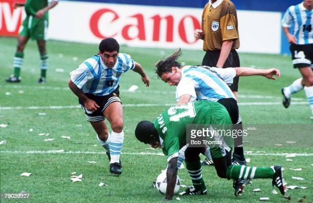 World Cup First Round Boston USA 25th June Argentina 2 v Nigeria 1 Nigeria's Samson Siasia is tackled by Argentina's Fernando Redondo as Diego...