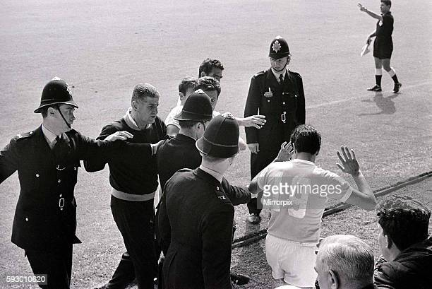 World Cup Football 1966 West Germany v Uruguay Referee Jim Finney calls for police assistance after Hector Silva refuses to leave the pitch after...