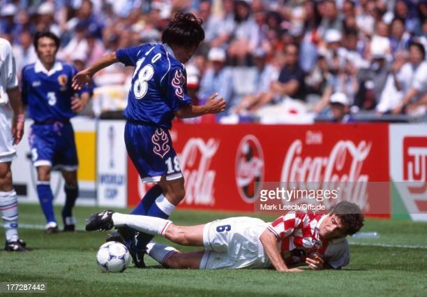 World Cup football Croatia v Japan Slaven Bilic falls as he is tackled by Shoji Jo