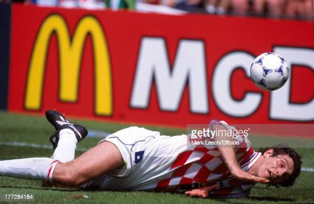 World Cup football Croatia v Japan Slaven Bilic falls as he is tackled