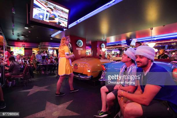 World Cup football fans watch the Germany v Mexico game on a TV in an American themed diner near Red Square on June 17 2018 in Moscow Russia Today...