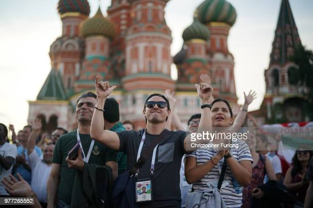 World Cup football fans watch the Germany v Mexico game on a TV near Red Square on June 17 2018 in Moscow Russia Today saw the first shock result of...