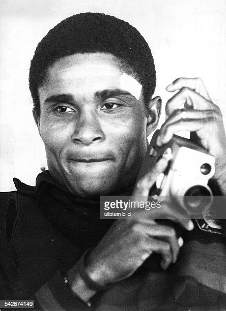 1966 FIFA World Cup in England Portrait of Portugal player Eusebio with a film camera June 1966