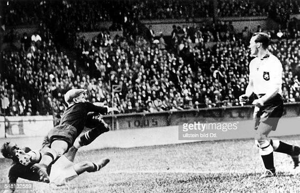 1938 FIFA World Cup in France Round of 16 in Paris Germany 1 1 Switzerland after extra time The Viennese German goalie Rudolf Raftl is diving to save...