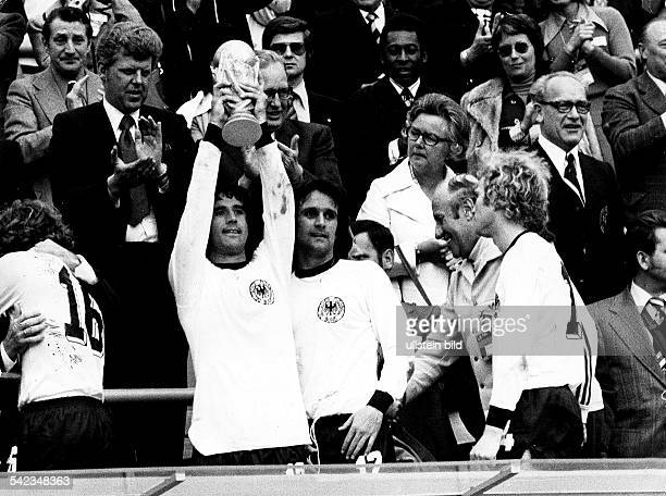 1974 FIFA World Cup in Germany Final in Munich Germany 2 1 Netherlands award ceremnoy| Gerd Mueller raising the World Cup trophy| right Wolfgang...