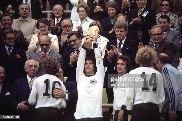 1974 FIFA World Cup in Germany Final in Munich Germany 2 1 Netherlands Gerd Mueller holding up the trophy at the award ceremony| towards the right...
