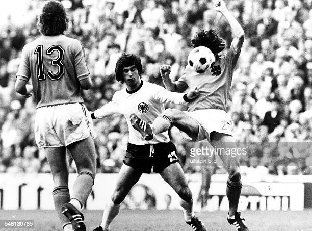 1974 FIFA World Cup in Germany Final in Munich Germany 2 1 Netherlands Scene of the match Gerd Mueller in a tackle with two Dutch players| left van...