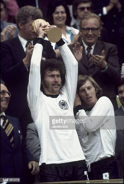 1974 FIFA World Cup in Germany Paul Breitner * Football player defender of the German national team Breitner raising the World Cup trophy| in the...