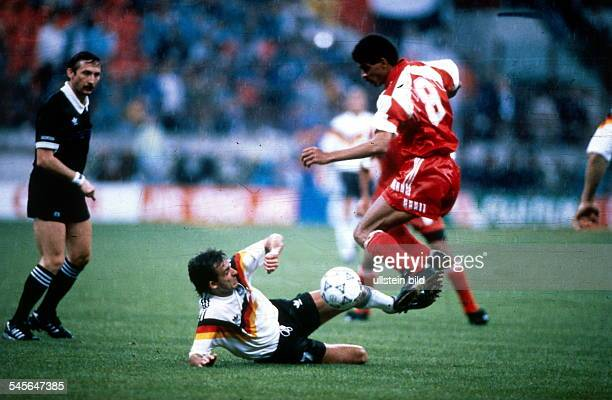 1990 FIFA World Cup in Italy First round Group D in Milan Germany 5 1 United Arab Emirates Scene of the match tackle between Mubarak and German...
