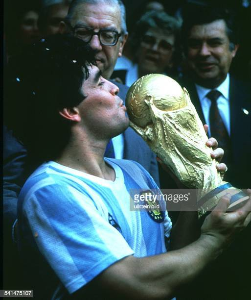 World Cup in Mexico Diego Armando Maradona *- Football player, member of the Argentine national team - Maradona kissing the World Cup trophy -