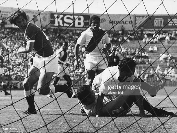 1970 FIFA World Cup in Mexico First round Group 4 Germany 3 1 Peru Scene of the match in the Peruvian penalty box| bottom goalie Rubinos| on top of...