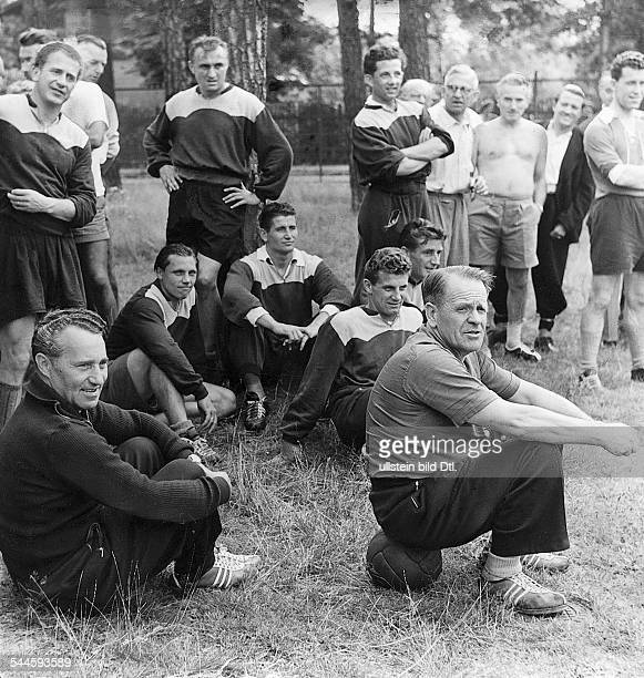 1954 FIFA World Cup in Switzerland Coach Sepp Herberger and the German squad are taking a break from their training in Spiez July 1954