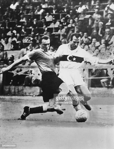 1954 FIFA World Cup in Switzerland First round Group 2 decider in the Zurich Hardtturm Stadium Germany 7 2 Turkey Tackle between Josef Posipal and...