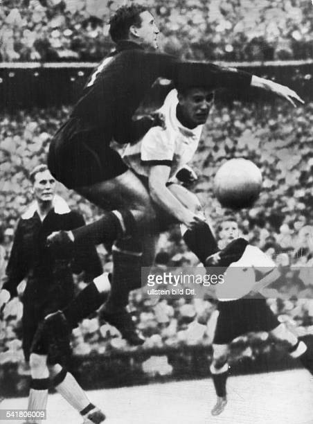 1954 FIFA World Cup in Switzerland Gyula Grosics * Football player goalkeeper Hungary Grosics in a tackling with the German player Schaefer at the...