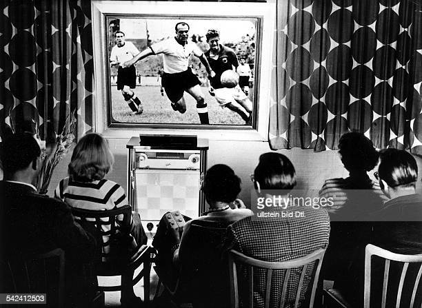 1954 FIFA World Cup in Switzerland Making a cinema of your livingroom people watching the World Cup match Germany Yugoslavia |