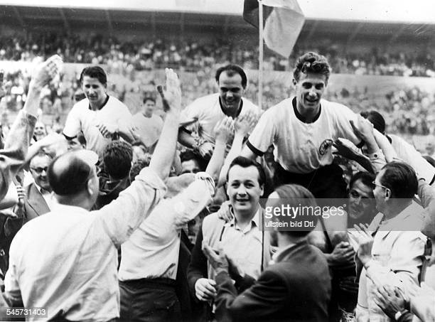 1954 FIFA World Cup in Switzerland Quarterfinal before 15000 spectators in Geneva Germany 2 0 Yugoslavia German fans carry Helmut Rahn Werner...