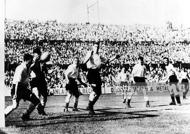 1954 FIFA World Cup in Switzerland Quarterfinal before 25000 spectators in Basel Uruquay 4 2 England Scene of the match in the English penalty area...