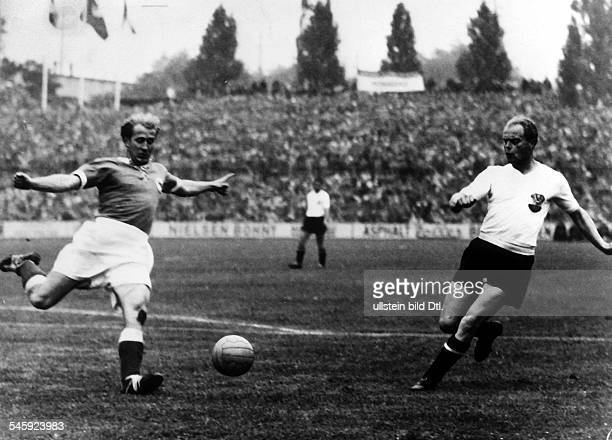 1954 FIFA World Cup in Switzerland Semifinal in the Sankt Jakob Stadium in Basel Germany 6 1 Austria Cross from German player Werner Liebrich| right...