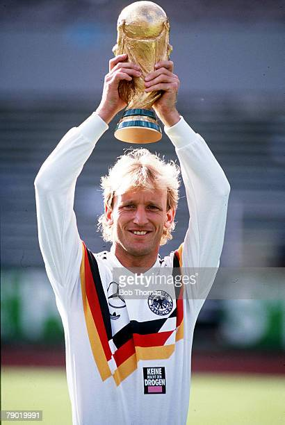 World Cup Italy West Germany's Andreas Brehme holds aloft the trophy at a photocall following their victory over Argentina in Rome