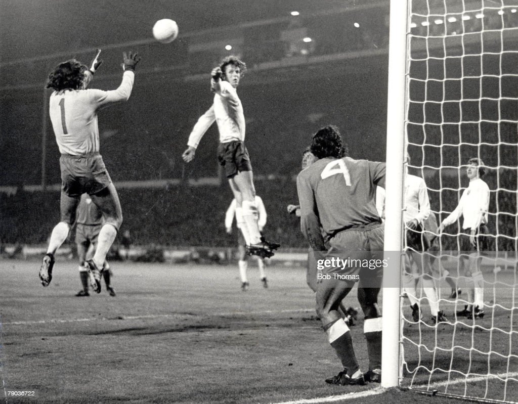 1973 World Cup Qualifier. Wembley Stadium. 17th October, 1973. England 1 v Poland 1. England striker Mick Channon jumps but is beaten to the high ball by Polish goalkeeper Jan Tomaszewski during their vital World Cup qualifier. The 1-1 draw meant that Eng : News Photo