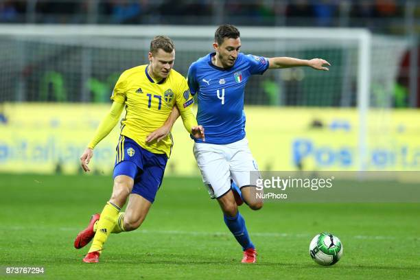 World Cup Qualifiers playoff Switzerland v Northern Ireland Viktor Claesson of Sweden and Matteo Darmian of Italy at San Siro Stadium in Milan Italy...