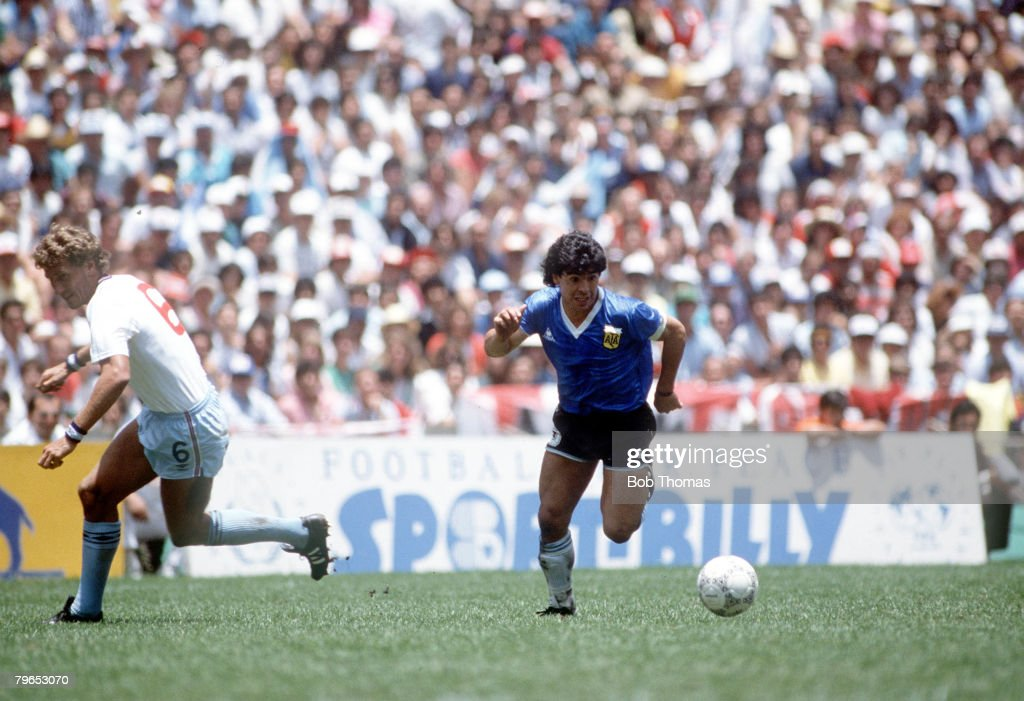 1986 World Cup Quarter Final, Azteca Stadium, Mexico, 22nd June, 1986, Argentina 2 v England 1, Argentina's Diego Maradona moves past English defender Terry Butcher on his way to scoring his outstanding individual second goal : News Photo