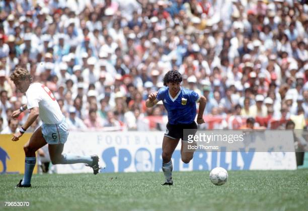 World Cup Quarter Final Azteca Stadium Mexico 22nd June Argentina 2 v England 1 Argentina's Diego Maradona moves past English defender Terry Butcher...