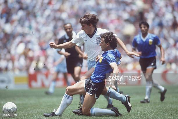 World Cup Quarter Final Azteca Stadium Mexico 22nd June Argentina 2 v England 1 England's Peter Beardsley battles for the ball with Argentina's Jose...