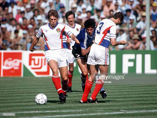 World Cup Quarter Final Florence Italy 30th June Argentina 0 v Yugoslavia 0 Argentina's Jorge Burruchaga is challenged for the ball by Yugoslavia's...