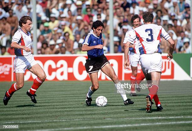 World Cup Quarter Final Florence Italy 30th June Argentina 0 v Yugoslavia 0 Argentina's Jorge Burruchaga on the ball watched by Yugoslav players