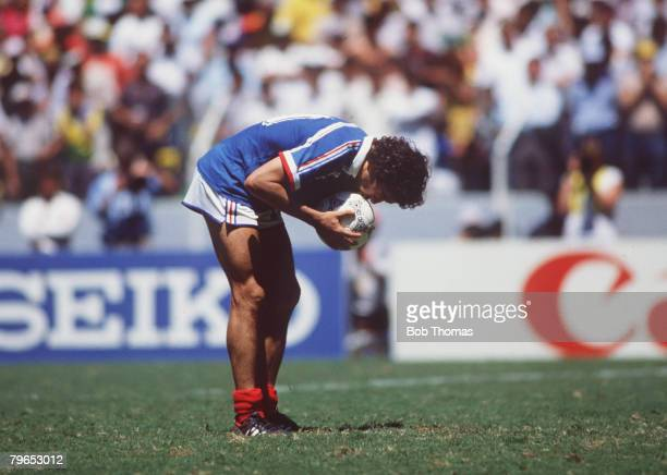 World Cup Quarter Final Guadalajara Mexico 21st June France 1 v Brazil 1 France's Michel Platini kisses the ball for luck before missing his penalty...
