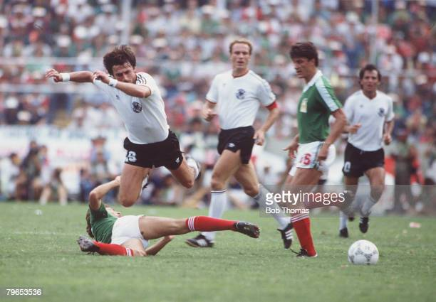 World Cup Quarter Final Monterrey Mexico 21st June West Germany 0 v Mexico 0 West Germany's Klaus Aloffs goes flying as he tries to win the ball