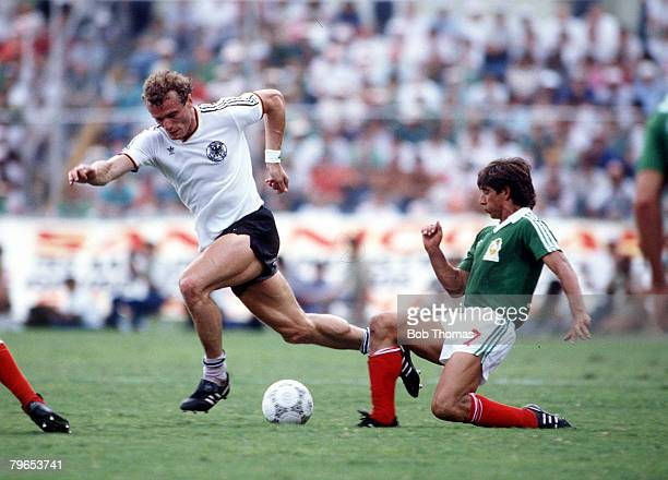 World Cup Quarter Final Monterrey Mexico 21st June West Germany 0 v Mexico 0 West Germany's Hans Peter Briegel moves past Mexico's Miguel Espana with...