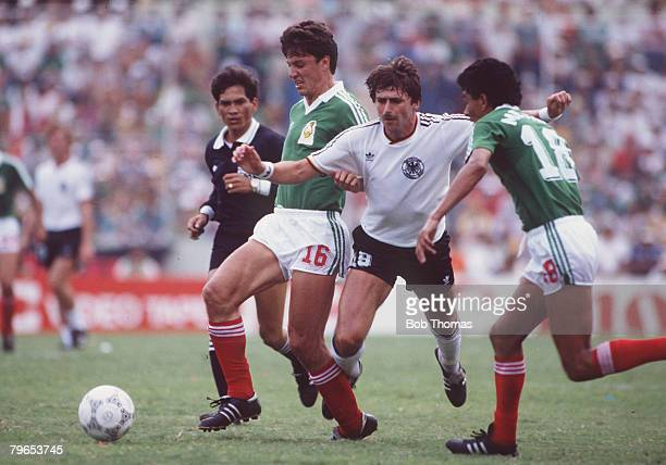 World Cup Quarter Final Monterrey Mexico 21st June West Germany 0 v Mexico 0 West Germany's Klaus Aloffs is challenged for the ball by Mexico's...