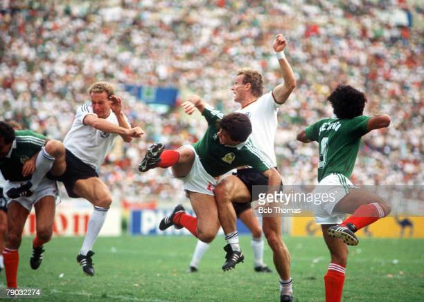 World Cup Quarter Final Monterrey Mexico 21st June West Germany 1 v Mexico 1 West Germany's Karl Heinz Rummenigge and Hans Peter Breiegel causes...
